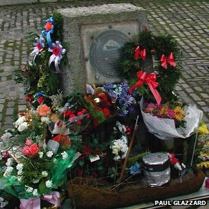 Fishermen's memorial covered in wreaths