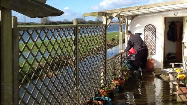 Ron Smith, who lives in Aller, keeps an eye on flood water levels