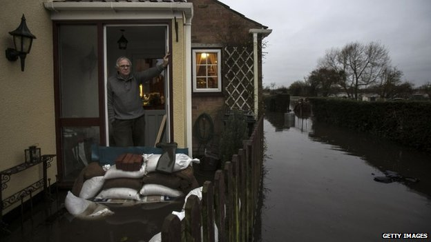 Phil Smithen at flooded house in Moorland