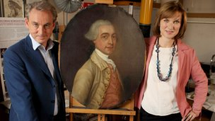 Philip Mould and Fiona Bruce with the portrait of Joseph Gape