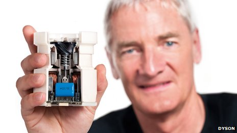 Sir James Dyson holding an impeller unit