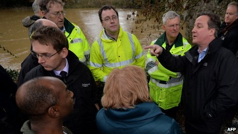 Prime Minister David Cameron with residents and emergency workers in Yalding, Kent