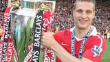 Manchester United's Nemanja Vidic with the Premier League trophy at Old Trafford in 2011