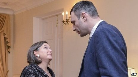 Head of UDAR (Punch) party Vitaly Klitschko (right) welcomes US State Department Assistant Secretary of State for European and Eurasian Affairs Victoria Nuland prior talks with the Ukrainian opposition in Kiev late 6 February 2014