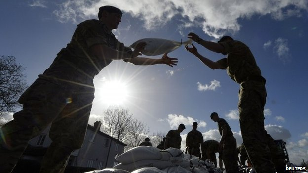 Royal Marines from 40 Commando lay sandbag water defences in the village of Moorland