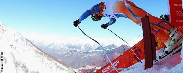 Aksel Lund Svindal pushes out of the start gate during a training run in Sochi