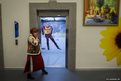 A Russian woman in a traditional dress at a media centre in Rosa Khutor near Sochi, Russia