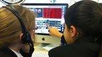 Schoolchildren working at a computer