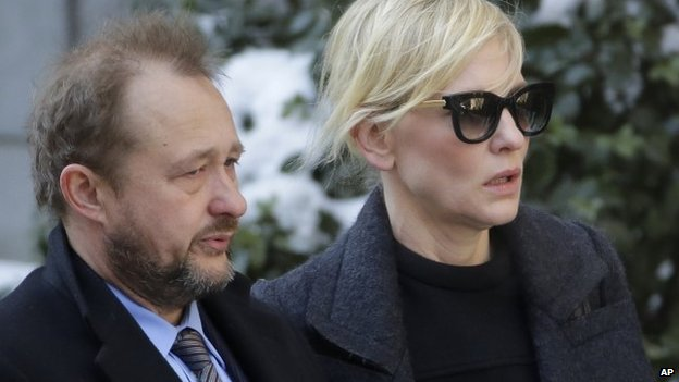 Filmmaker Andrew Upton, left, and his wife Cate Blanchett arrive for the funeral of actor Philip Seymour Hoffman at the Church of St. Ignatius Loyola 7 February 2014