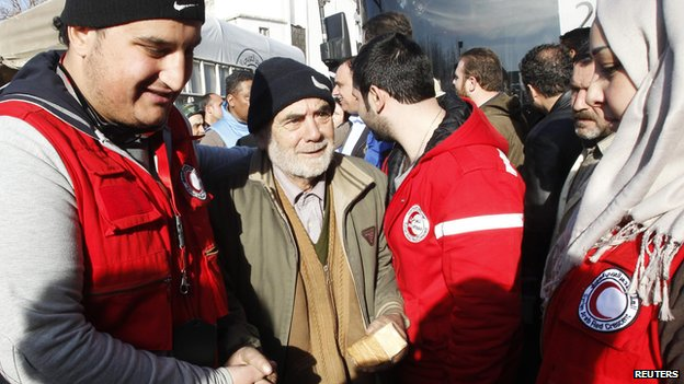 Members of the Syrian Arab Red Crescent assist a man evacuated from a besieged area of Homs, after his arrival to the area under government control (February 7, 2014)