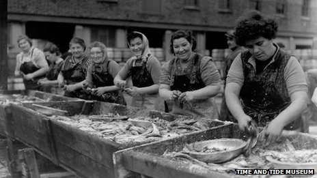 Women preparing the herring