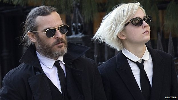 Actor Joaquin Phoenix (L) arrives for actor Philip Seymour Hoffman's funeral at the Church of St Ignatius Loyola in New York on 7 February 2014