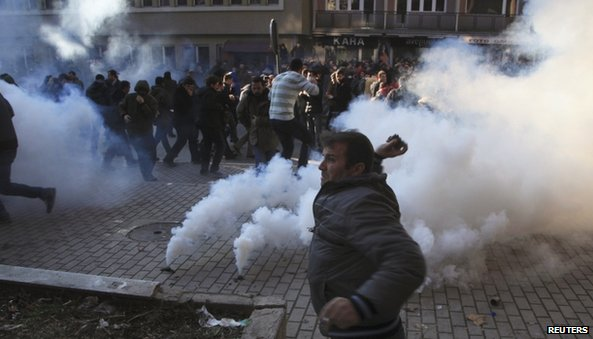 Protesters throw tear gas in Pristina