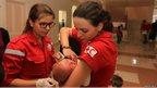 Medics with baby