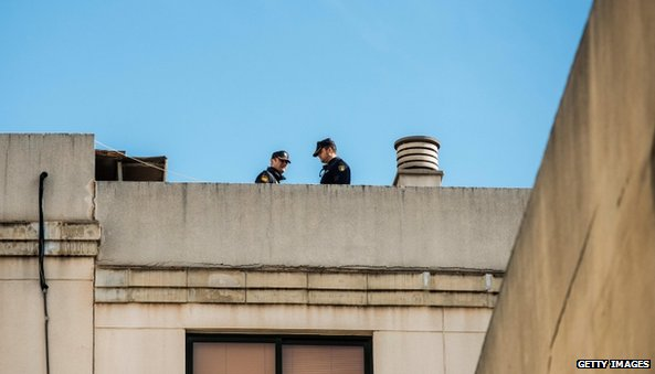 Police officers guard the roof of a building next to the Palma de Mallorca Courthouse