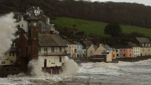 The village of Kingsand being hit by large waves