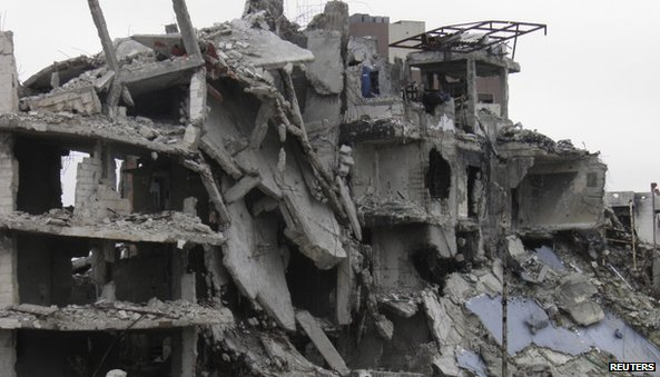 A damaged building is seen in the besieged area of Homs