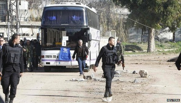 A bus transports residents from a besieged area of Homs to the area under government control (February 7, 2014)