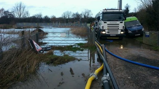 Floodwater threatening a substation near Reading
