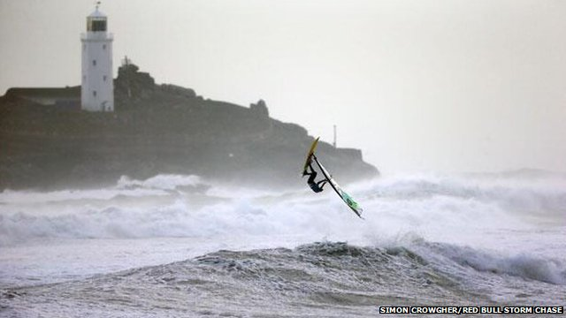 Professional windsurfer in Gwithian, in Cornwall,