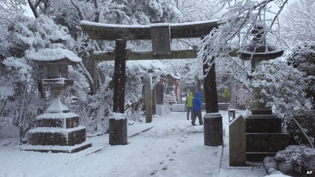 Visitors walk in the snow at Enoshima Shrine in Fujisawa, near Tokyo