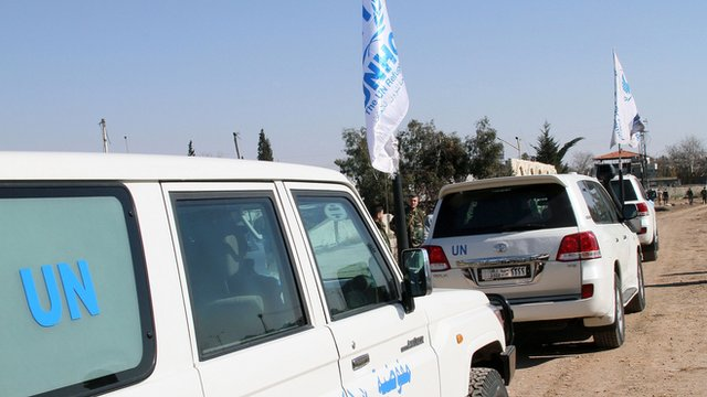 UN vehicles used to evacuate civilians from the rebel-held areas of Homs