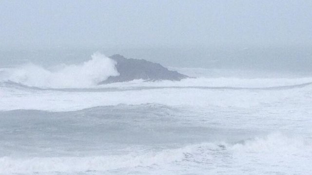 Goose Rock off Crantock Beach in Newquay being attacked by another wave