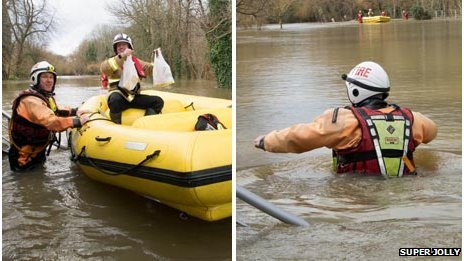 Firefighters help people trapped by floods in Wraysbury, Surrey
