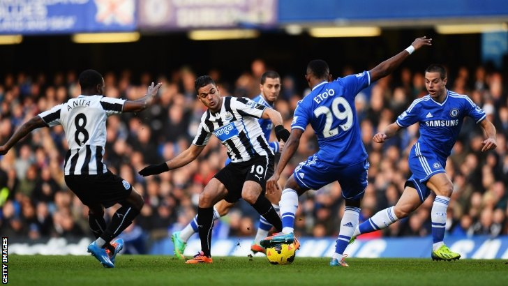 Players from Chelsea and Newcastle compete for the ball