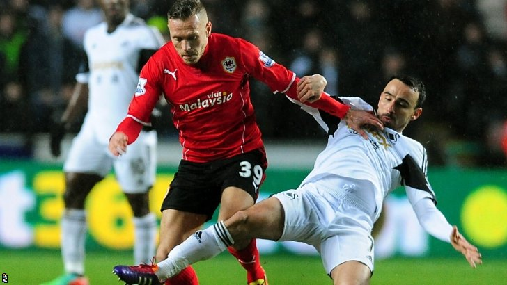 Cardiff's Craig Bellamy (left) and Swansea's Leon Britton