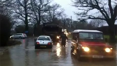 Soldiers helped pull cars from the flood water near Tostock