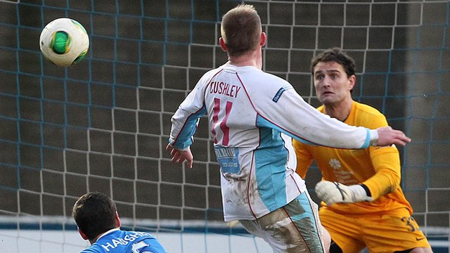 Ballymena United's David Cushley fires the winner past Linfield's Jonny Tuffey