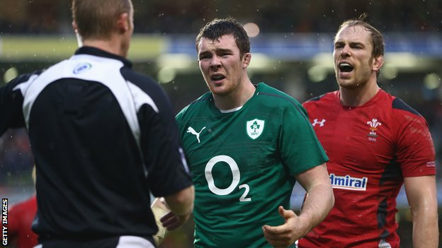 Referee Wayne Barnes give Peter O'Mahony a telling off as Wales' Alun Wyn Jones looks on