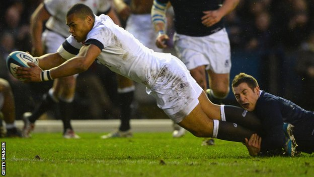 Luther Burrell dives over to score England's opening try at Murrayfield
