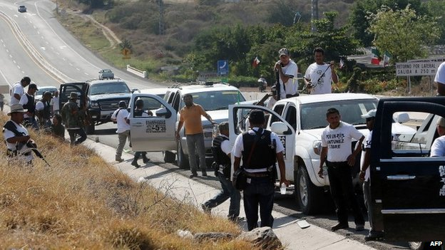 Vigilantes outside Apatzingan