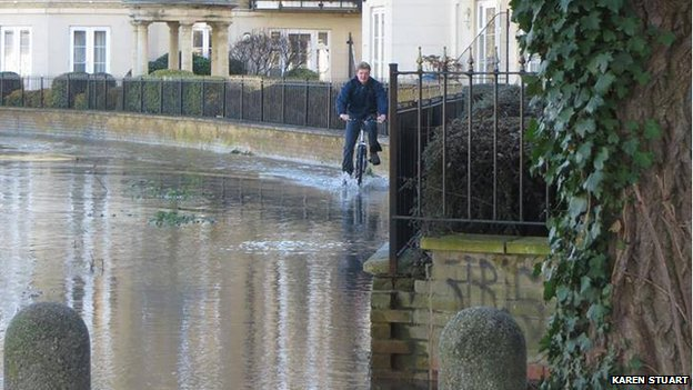Cyclist in flood on Brigham Road in Reading