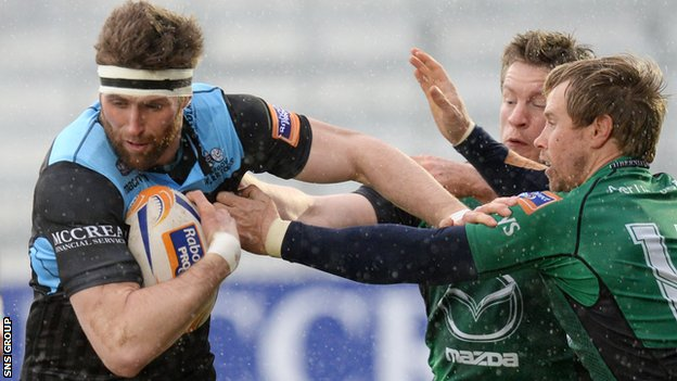 Glasgow Warriors' Richie Vernon (left) is tackled by Matt Healy