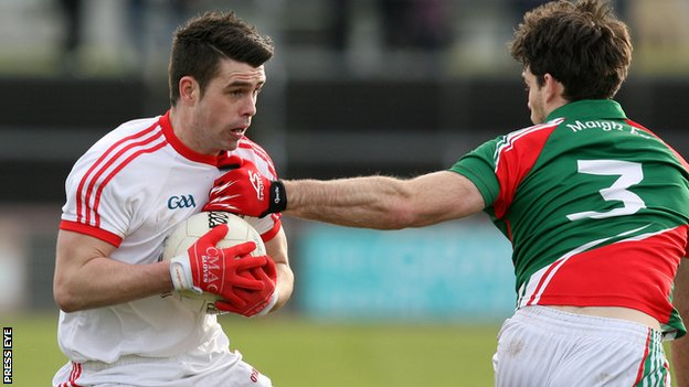 Darren McCurry of Tyrone in action against Mayo defender Ger Cafferkey