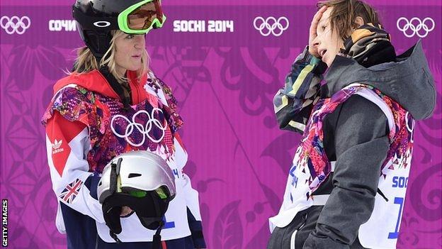 Czech Republic's Sarka Pancochova (R) speaks with Great Britain's Jenny Jones after crashing