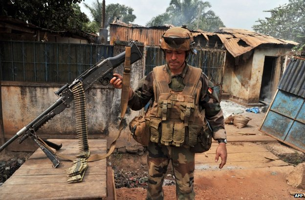 A French soldier near ruined homes in Bangui, CAR, 9 February