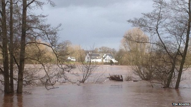 House at Llanfair Gobion surrounded by water