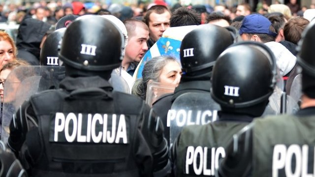Bosnian citizens' rights activists argue with riot police