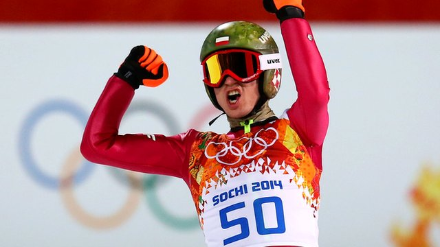 Poland's Kamil Stoch leaps to gold in the men's individual normal hill ski jump
