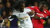 Swansea City's Marvin Emnes and Cardiff City's Wilfried Zaha