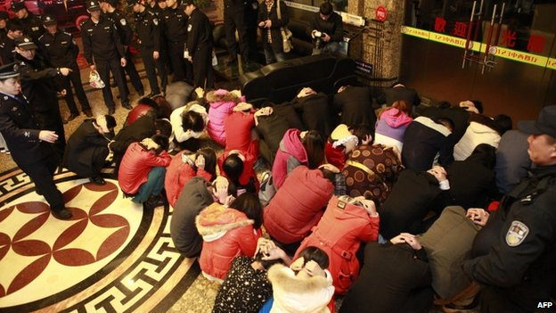 Chinese police round up alleged sex workers and clients at an entertainment centre in Dongguan, southern China's Guangdong province, 9 February 2014