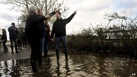 Nick Clegg is shown around a flooded site in Burrowbridge, Somerset