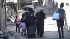 Evacuations resume in Syria's Homs