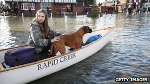 Beatrix Thurner is evacuated from a flooded house with pet dog Ruby