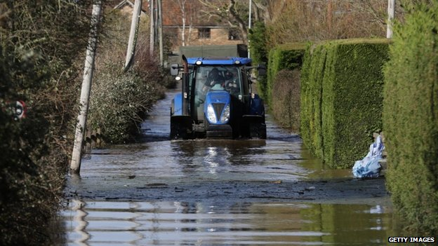 A tractor drives in flood water at Burrowbridge on the Somerset Levels on 9 February 2014.