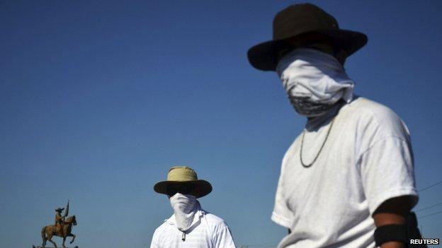 Vigilantes stand at a checkpoint in Mugica near Apatzingan on 14 January, 2014